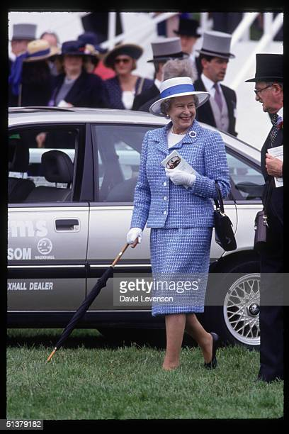 Queen Elizabeth II walks along the course to the paddock at the start of the Epsom Derby on June 2 1993 at Epsom Racecourse in Epsom Surrey