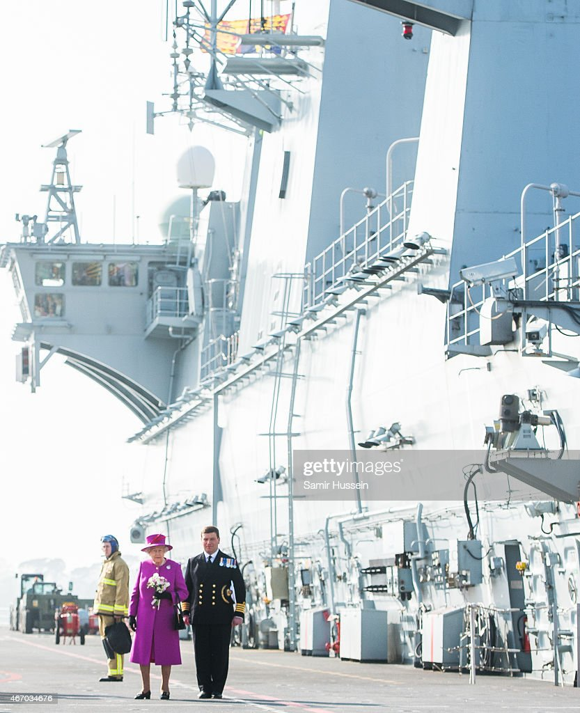 Queen Elizabeth II walks along the flight deck as she visits HMS Ocean on March 20, 2015 in Plymouth, England.