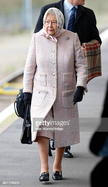 Queen Elizabeth II walks along the platform at King's Lynn railway station after arriving by train to begin her annual Christmas break at Sandringham...