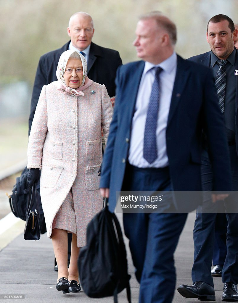 Queen Elizabeth II walks along the platform at King's Lynn railway station after arriving by train to begin her annual Christmas break at Sandringham House on December 17, 2015 in King's Lynn, England.