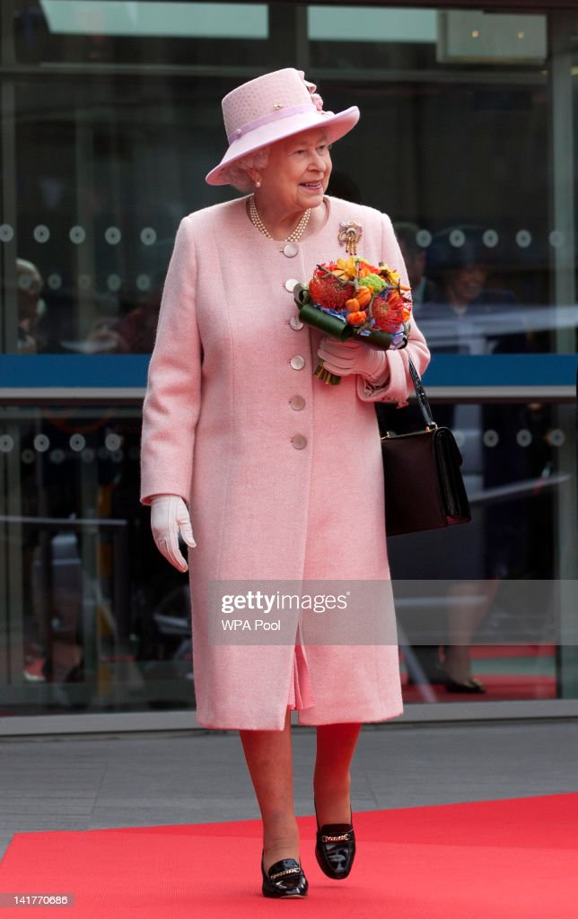 Queen <a gi-track='captionPersonalityLinkClicked' href=/galleries/search?phrase=Elizabeth+II&family=editorial&specificpeople=67226 ng-click='$event.stopPropagation()'>Elizabeth II</a> walks down a red carpet during her visit to the Manchester Central convention centre on March 23, 2012 in Greater Manchester, north-west England. The Queen and her husband, Prince Philip, the Duke of Edinburgh visited Manchester where she officially opened hospitals, toured the new BBC building at MetroCity and officially started a Sport Relief Mile fun run.