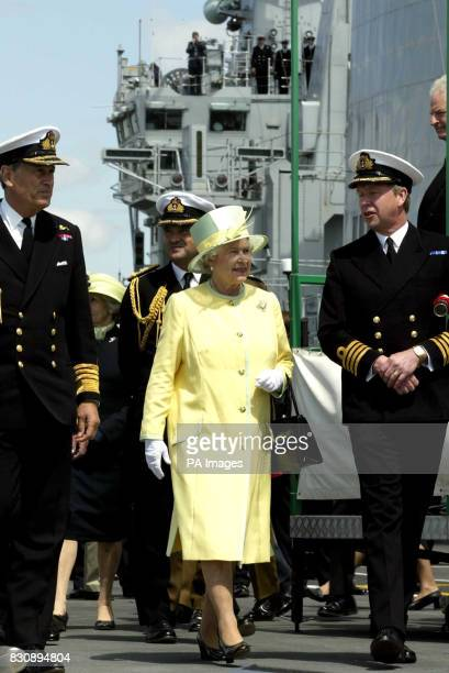 Queen Elizabeth II walks on the deck of the aircraft carrier HMS Ark Royal during a visit to Portsmouth The Queen and Duke of Edinburgh spent a day...
