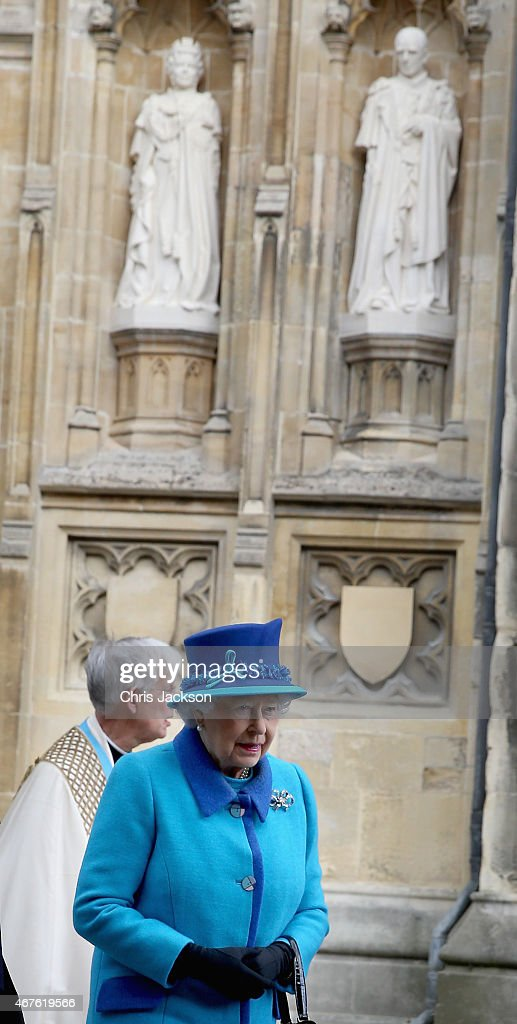 Queen Elizabeth II walks past a Statue of herself and the Duke of Edinburgh she unveiled to celebrate the Queen's Diamond Jubilee as she visits Canterbury Cathedral on March 26, 2015 in Canterbury, England.