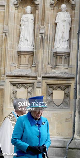 Queen Elizabeth II walks past a Statue of herself and the Duke of Edinburgh she unveiled to celebrate the Queen's Diamond Jubilee as she visits...
