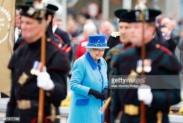 Queen Elizabeth II walks past an honour guard of Royal Archers as she opens the new Scottish Border's Railway during a visit to Tweedbank Station on...