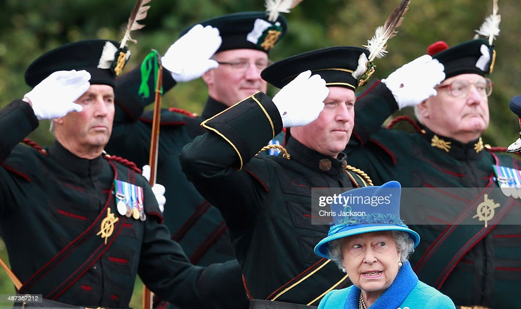 Queen Elizabeth II walks past ceremonial archers as she arrives at Tweedbank Station on September 9, 2015 in Tweedbank, Scotland. Today, Her Majesty Queen Elizabeth II becomes the longest reigning monarch in British history overtaking her great-great grandmother Queen Victoria's record by one day. The Queen has reigned for a total of 63 years and 217 days. Accompanied by her husband, the Duke of Edinburgh and Scotland's First Minister Nicola Sturgeon, she will officially open the new Scottish Border's Railway which runs from the capital to Tweedbank.