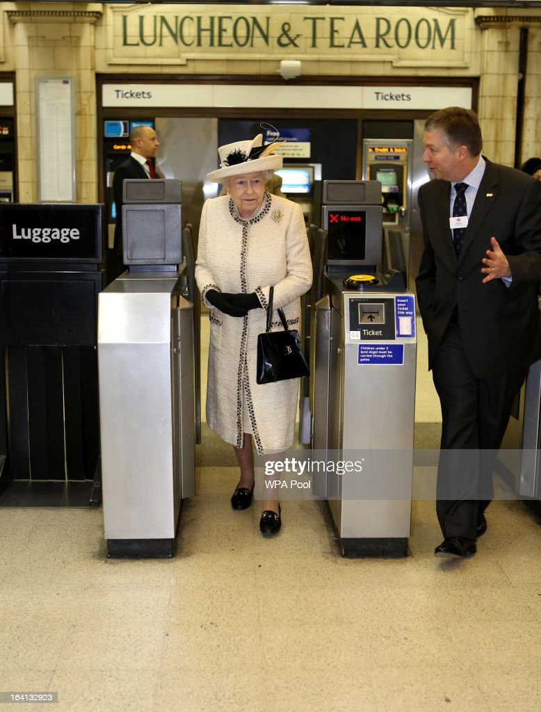 Queen Elizabeth II walks through a ticket barrier as she makes an official visit to Baker Street Underground Station, to mark 150th anniversary of the London Underground on March 20, 2013 in London, England.