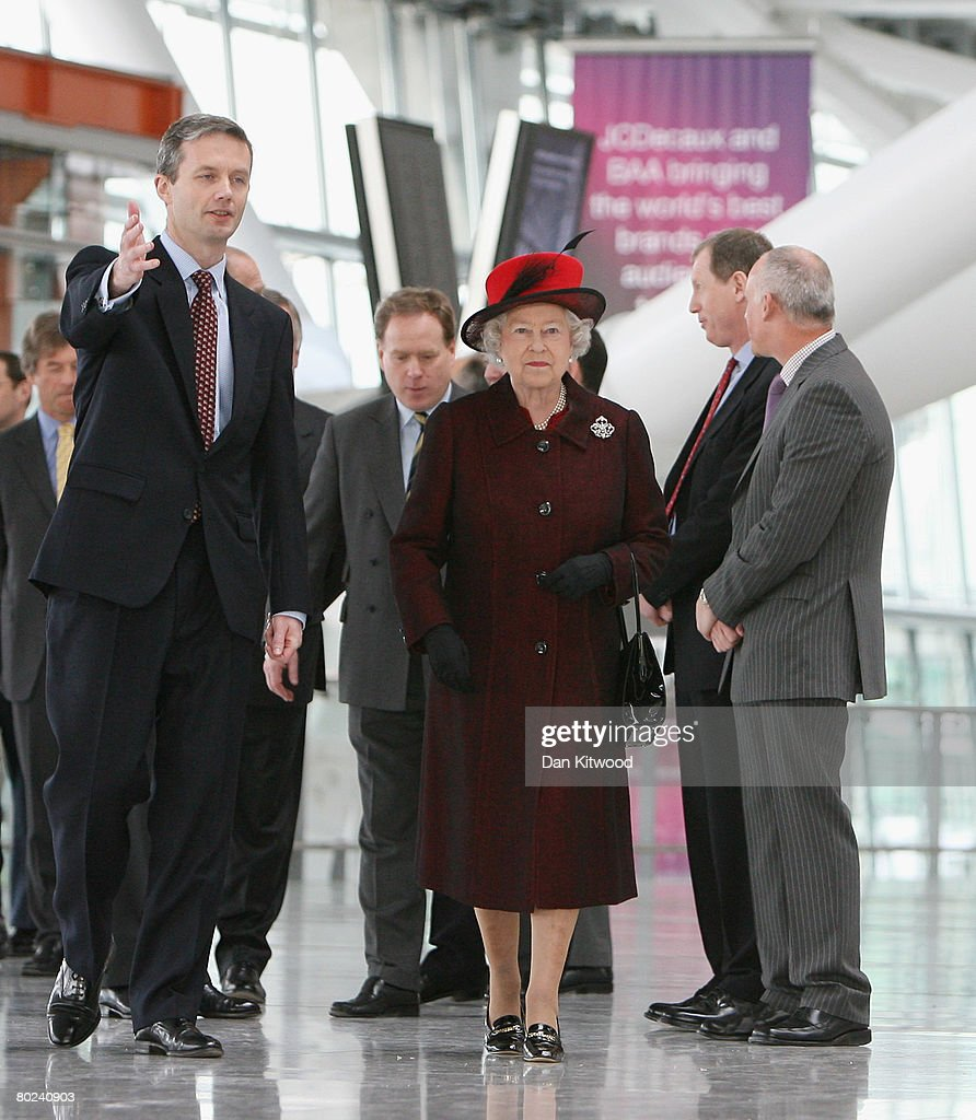 Queen <a gi-track='captionPersonalityLinkClicked' href=/galleries/search?phrase=Elizabeth+II&family=editorial&specificpeople=67226 ng-click='$event.stopPropagation()'>Elizabeth II</a> walks through the new Terminal 5 at Heathrow with CEO Stephen Nelson on it's official opening on March 14, 2008 in London, England. Terminal 5 will be open to the public on March 27, 2008.