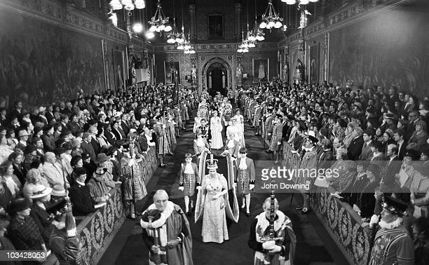 Queen Elizabeth II walks through the Royal Gallery in the Palace of Westminster during the State Opening of Parliament on November 06 1984