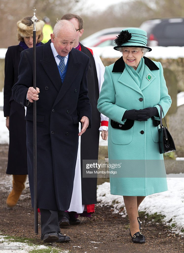 Queen Elizabeth II walks through the snow covered church yard after attending Sunday Service at the Church of St Lawrence in Castle Rising near the Sandringham Estate on January 20, 2013 near King's Lynn, England.