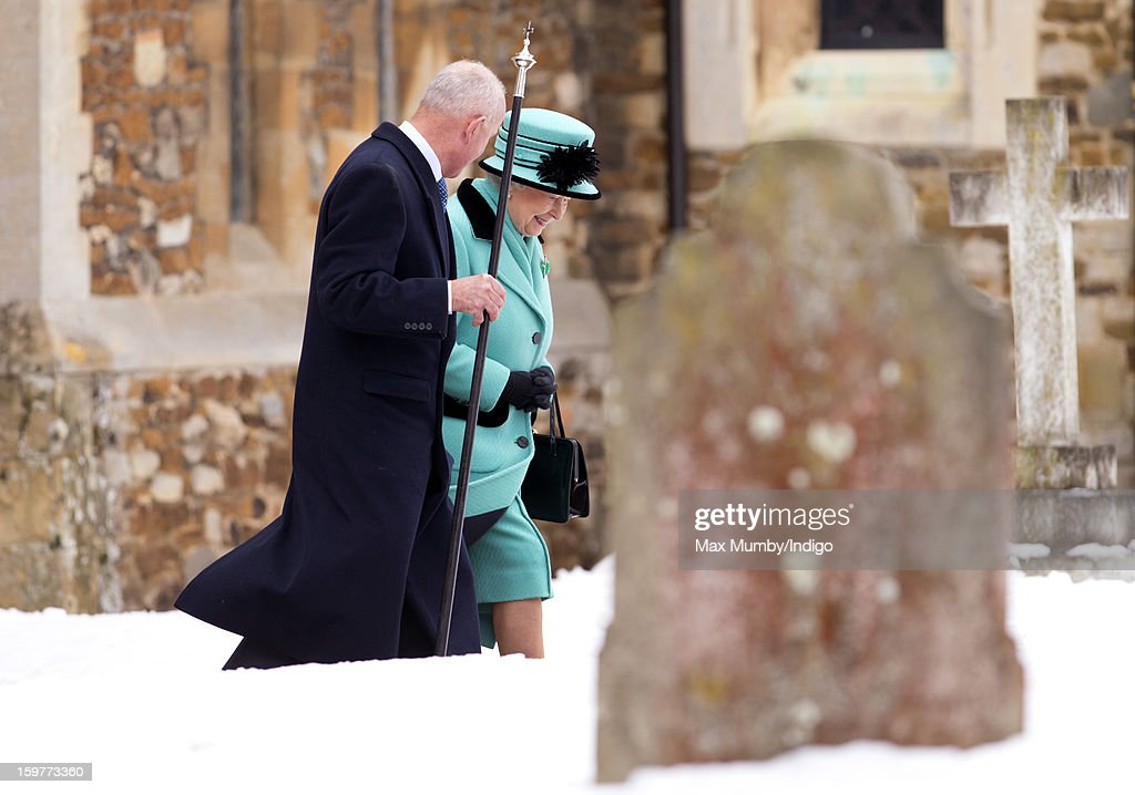 Queen <a gi-track='captionPersonalityLinkClicked' href=/galleries/search?phrase=Elizabeth+II&family=editorial&specificpeople=67226 ng-click='$event.stopPropagation()'>Elizabeth II</a> walks through the snow covered church yard after attending Sunday Service at the Church of St Lawrence in Castle Rising near the Sandringham Estate on January 20, 2013 near King's Lynn, England.