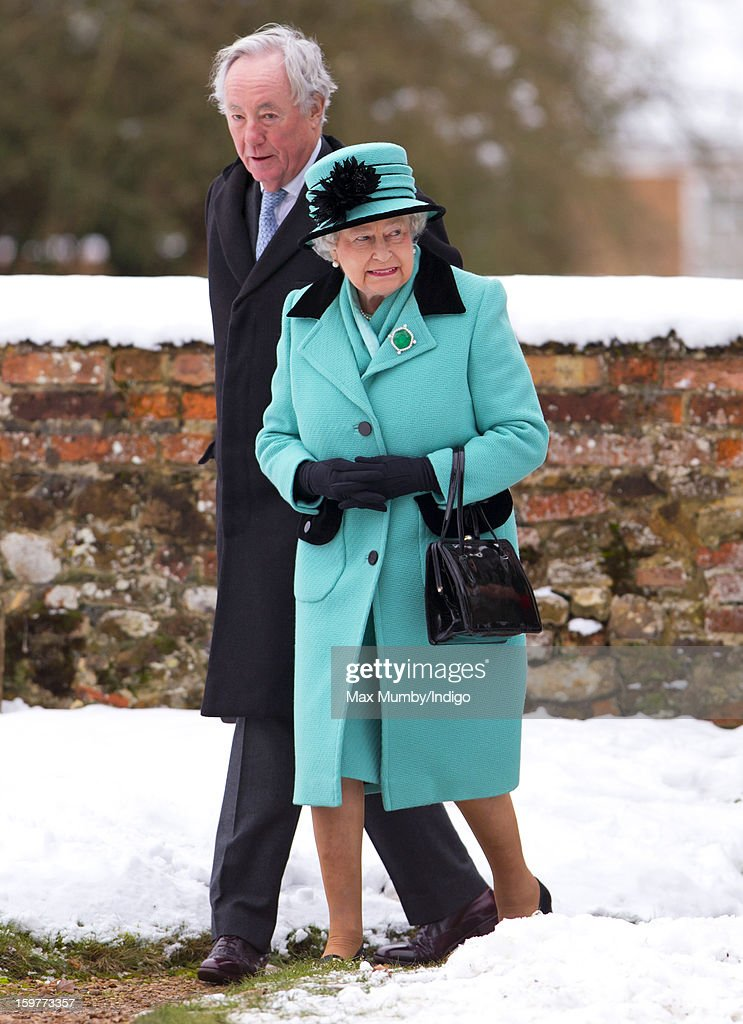 Queen Elizabeth II walks through the snow covered church yard to attend Sunday Service at the Church of St Lawrence in Castle Rising near the Sandringham Estate on January 20, 2013 near King's Lynn, England.