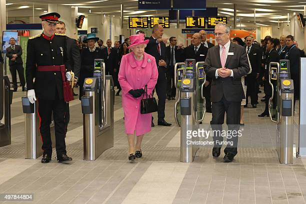 Queen Elizabeth II walks through the ticket barriers during the official opening of the refurbished Birmingham New Street Station on November 19 2015...