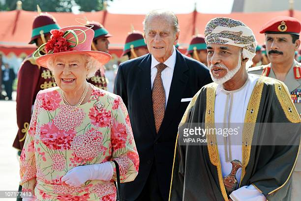 Queen Elizabeth II walks towards her plane with the Sultan of Oman His Majesty Sultan Qaboos bin Said before she and the Prince Phillip Duke of...