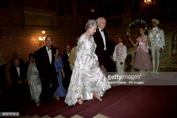 Queen Elizabeth II walks up the steps inside Hungary's National Opera House in Budapest with the Minister for Education and Science Dr Ference Madl...