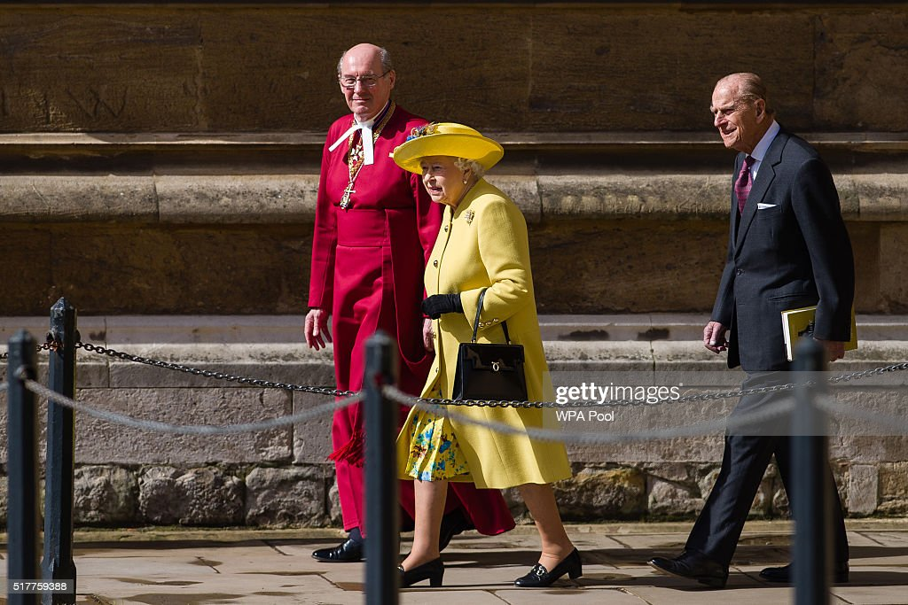Queen Elizabeth II (C) walks with Dean of Windsor David Conner (L) followed by Prince Philip, Duke of Edinburgh as they leave after the Easter Sunday church service at St George's Chapel, Windsor Castle on March 27, 2016 in Windsor, England.