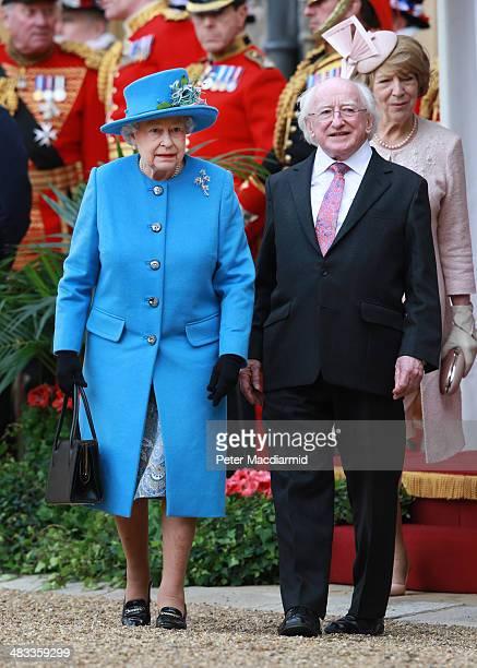 Queen Elizabeth II walks with President of Ireland Michael D Higgins and Sabina Higgins at Windsor Castle after a ceremonial welcome on April 8 2014...