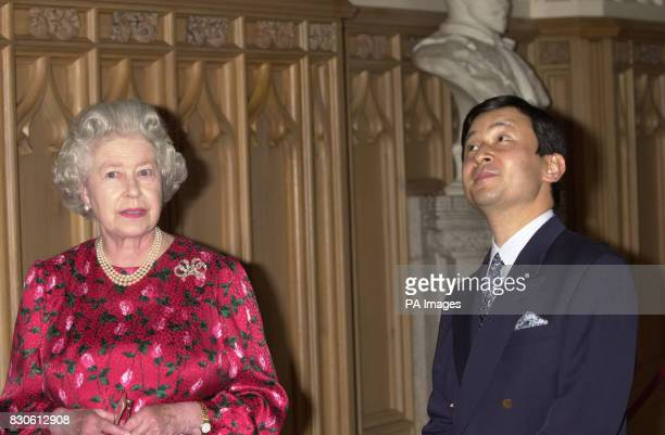 Queen Elizabeth II walks with the Crown Prince Naruhito of Japan in St George's Hall in Windsor Castle The Prince is on a week long visit to Britain...
