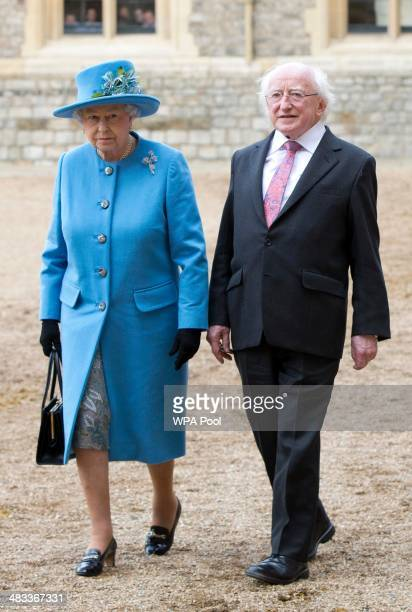 Queen Elizabeth II walks with the President of Ireland Michael D Higgins during a ceremonial welcome at Windsor Castle on April 8 2014 in Windsor...