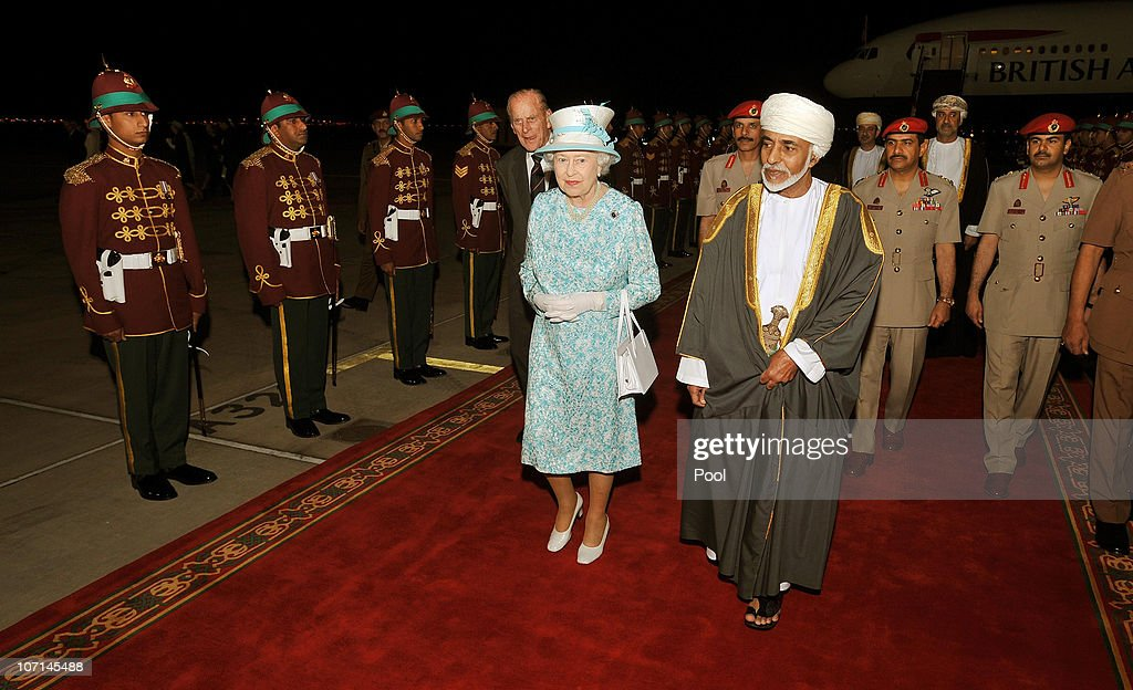 Queen Elizabeth II walks with the Sultan of Oman, His Majesty Qaboos bin Said Al Said, after arriving from the UAE on November 25, 2010 in Muscat, Oman. Queen Elizabeth II and Prince Philip, Duke of Edinburgh are in Oman on a State Visit to the Middle East. The Royal couple spent two days in Abu Dhabi and will stay three days in Oman.