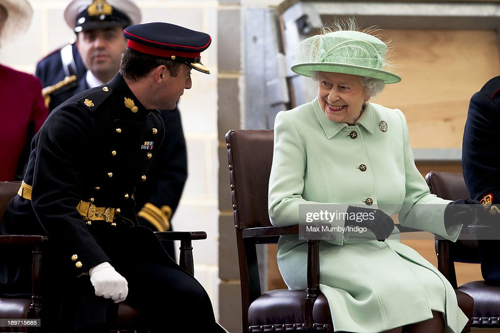 Queen Elizabeth II watches a gun carriage demonstration as she visits The King's Troop Royal Horse Artillery unit at Woolwich Barracks on May 31 2013...