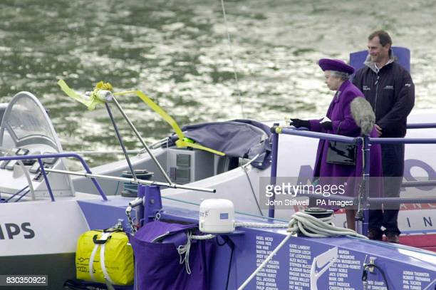 Queen Elizabeth II watches as the champagne smashes over the anchor of the Team Philips catamaran in the shadow of Tower bridge in London *The Queen...