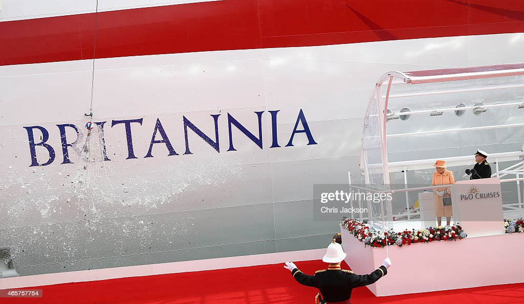Queen Elizabeth II watches champagne smash on the hull of Britannia as she takes part in the naming ceremony for the P&O Cruises vessel at Ocean Cruise Terminal on March 10, 2015 in Southampton, England. Britannia will carry over 3647 passengers and at 141,000 tons she will boost P&O's cruise ship capacity by 24%.