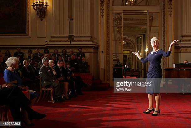 Queen Elizabeth II watches Dame Helen Mirren delivering a speech from Shakespeare's The Tempest during the Dramatic Arts reception in the Ballroom of...