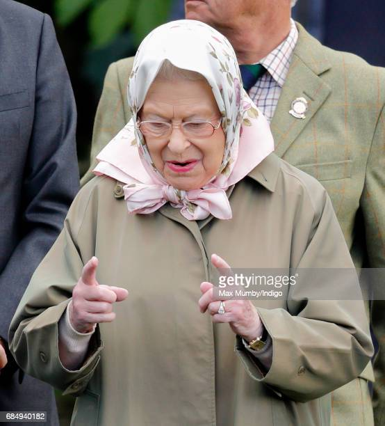 Queen Elizabeth II watches her horse 'Balmoral Angel' compete in the Highland Class on day 3 of the Royal Windsor Horse Show in Home Park on May 12...