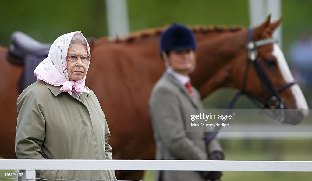 Queen Elizabeth II watches her horse Barbers Shop win the Tattersalls & Ror Thoroughbred Ridden Show Horse Class on day 3 of the Royal Windsor Horse Show on May 10, 2013 in Windsor, England.