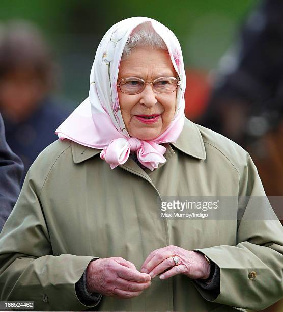 Queen Elizabeth II watches her horse Barbers Shop win the Tattersalls Ror Thoroughbred Ridden Show Horse Class on day 3 of the Royal Windsor Horse...