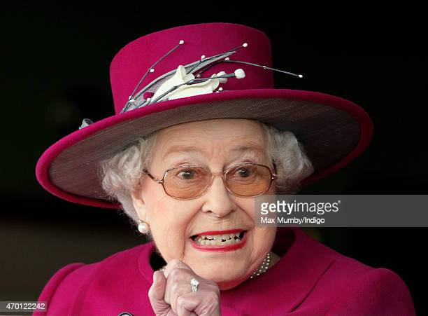 Queen Elizabeth II watches her horse 'Capel Path' run in the Dubai Duty Free Full of Surprises Handicap Stakes during the Dubai Duty Free Spring...