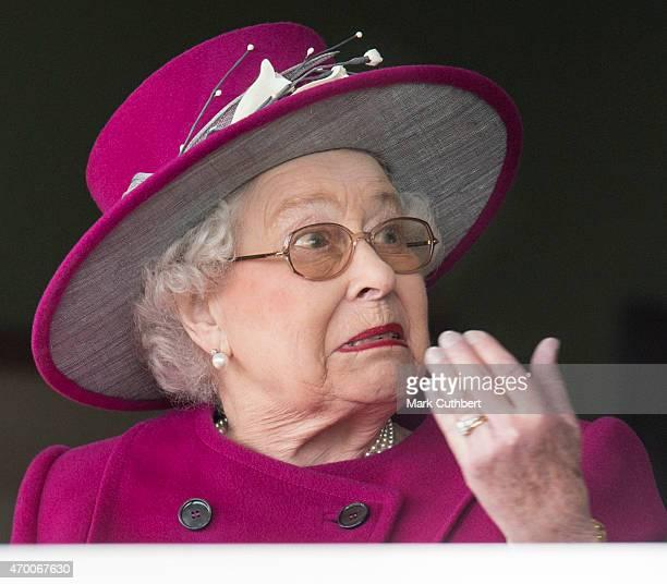 Queen Elizabeth II watches her horse 'Ring of Truth' in Race 2 at the Dubai Duty Free Spring Trials Meeting at Newbury Racecourse on April 17 2015 in...