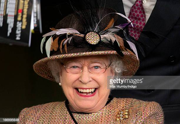 Queen Elizabeth II watches her horse 'Sign Manual' win The Dreweatts Handicap Stakes at Newbury Racecourse on April 19 2013 in Newbury England
