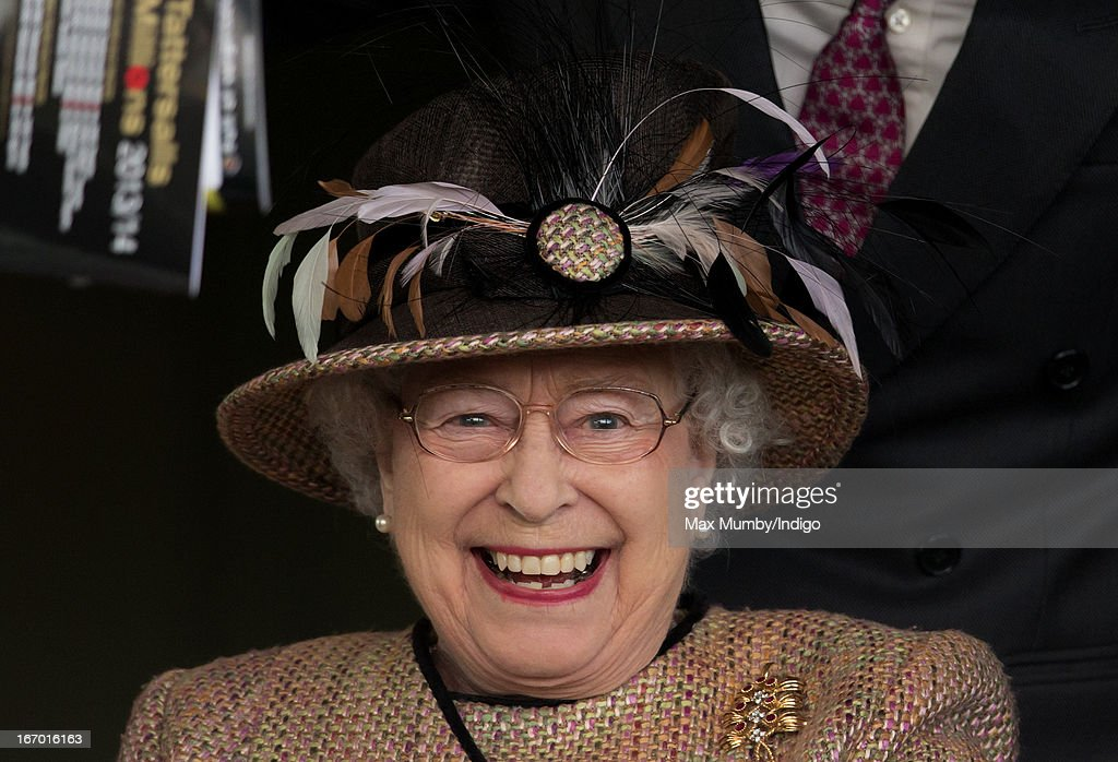 Queen Elizabeth II watches her horse 'Sign Manual' win the Dreweatts Handicap Stakes as she attends the Dubai Duty Free Raceday at Newbury Racecourse on April 19, 2013 in Newbury, England.