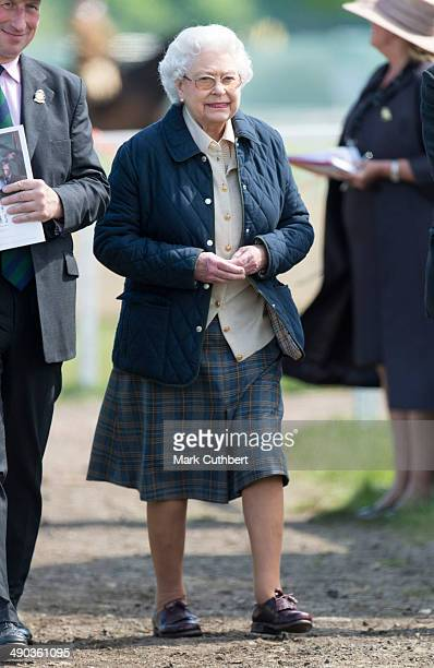 Queen Elizabeth II watches her horse 'Tower Bridge' at the Royal Windsor Horse Show at Home Park on May 14 2014 in Windsor England