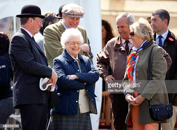Queen Elizabeth II watches her horse 'Tower Bridge' compete in the Novice Heavyweight Hunter class on day 1 of the Royal Windsor Horse Show at Home...