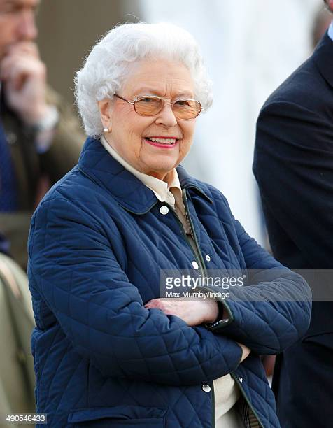 Queen Elizabeth II watches her horse 'Tower Bridge' compete in the Cuddy Four Year Old Hunter class on day 1 of the Royal Windsor Horse Show at Home...