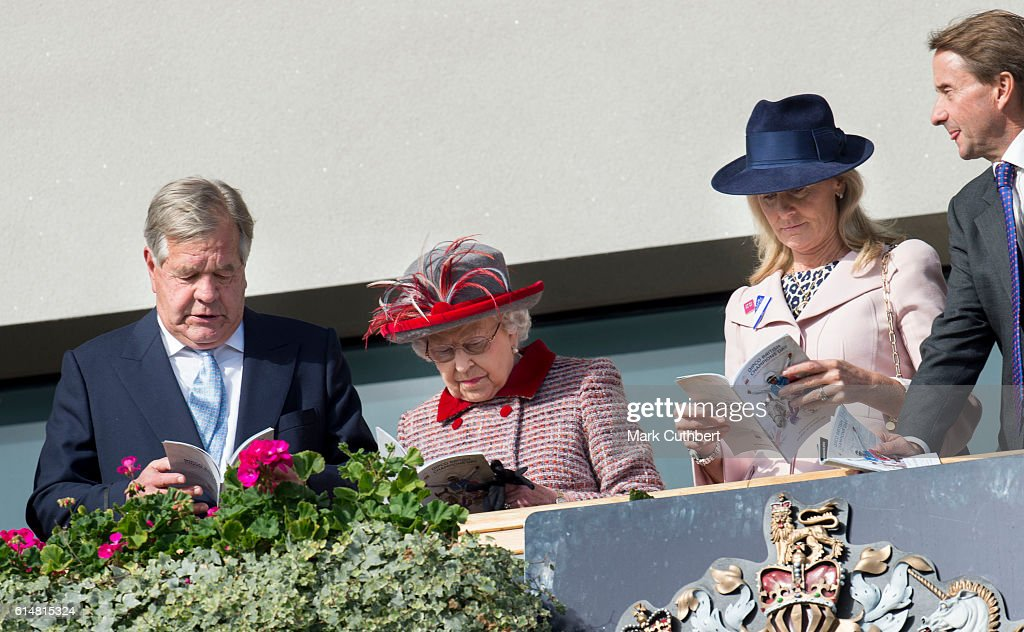 queen-elizabeth-ii-watches-the-horses-in-the-parade-ring-from-the-picture-id614815324