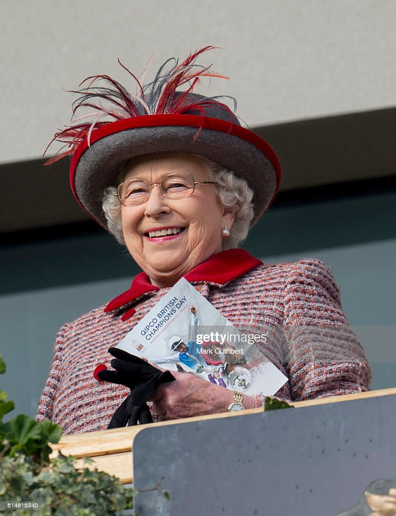 queen-elizabeth-ii-watches-the-horses-in-the-parade-ring-from-the-picture-id614815340