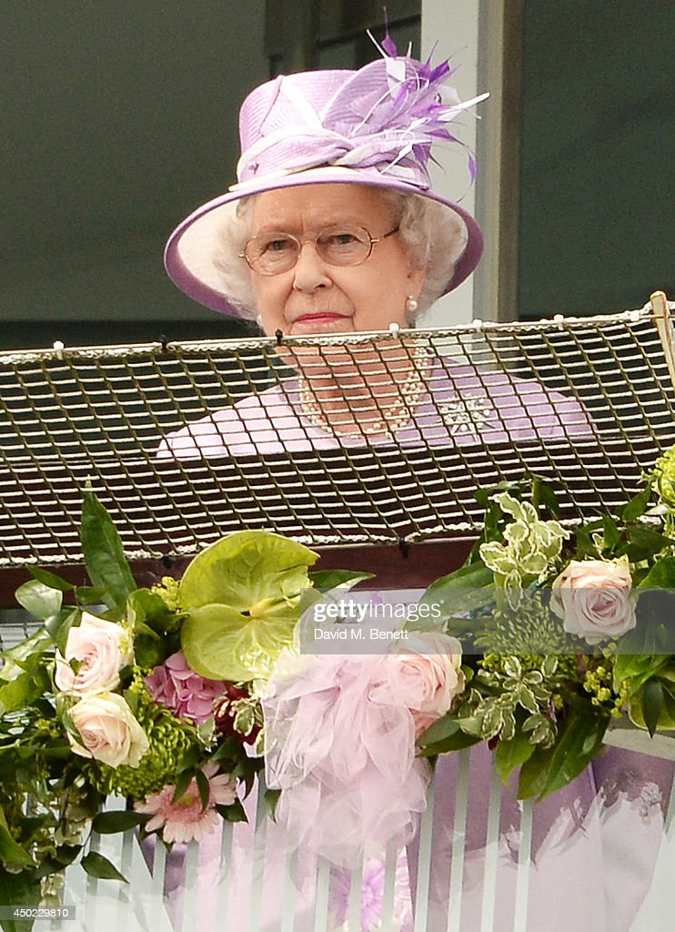 Queen Elizabeth II watches The Investec Derby during Derby Day at the Investec Derby Festival at Epsom Downs Racecourse on June 6, 2014 in Epsom, England.