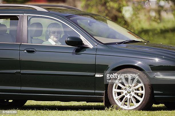 Queen Elizabeth II watches the Land Rover International Driving Grand Prix from her new Jaguar X Type estate car on the first day of the Royal...