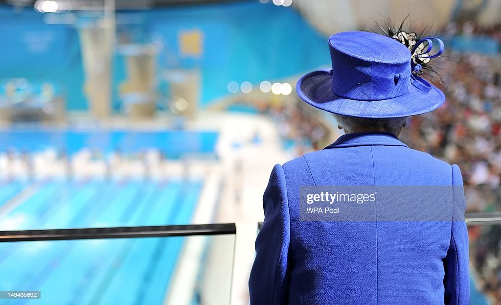 Queen <a gi-track='captionPersonalityLinkClicked' href=/galleries/search?phrase=Elizabeth+II&family=editorial&specificpeople=67226 ng-click='$event.stopPropagation()'>Elizabeth II</a> watches the morning session of the swimming at the Aquatics Centre during a tour of the Olympic Park on day one of the London 2012 Olympics Games on July 28, 2012 in London, England.