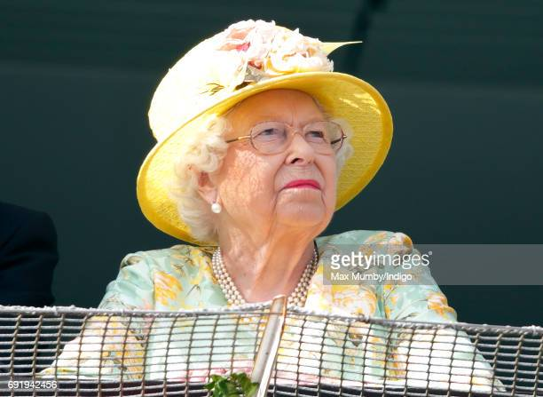 Queen Elizabeth II watches the racing as she attends Derby Day during the Investec Derby Festival at Epsom Racecourse on June 3 2017 in Epsom England