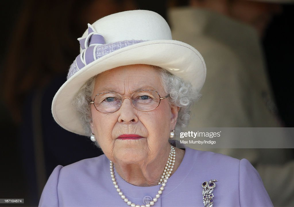 Queen Elizabeth II watches the racing as she attends the New to Racing Day at Newbury Racecourse on April 20, 2013 in Newbury, England.