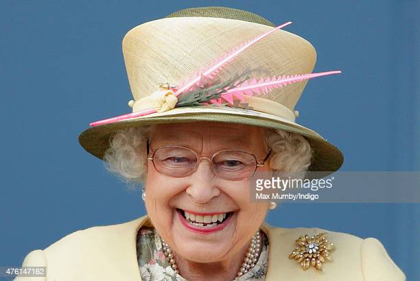 Queen Elizabeth II watches the racing from the balcony of the Royal Box as she attends Derby Day during the Investec Derby Festival at Epsom...