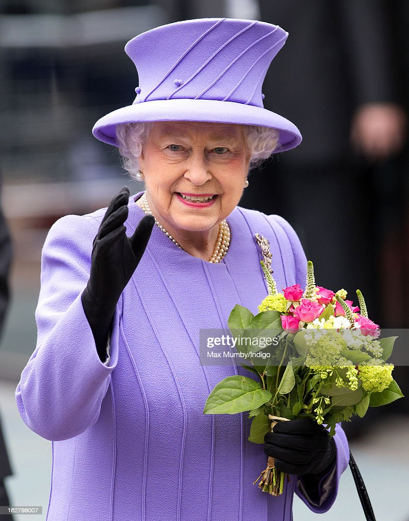 Queen Elizabeth II waves after opening the new National Centre for Bowel Research and Surgical Innovation at Queen Mary, University of London on February 27, 2013 in London, England.