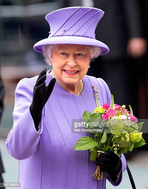Queen Elizabeth II waves after opening the new National Centre for Bowel Research and Surgical Innovation at Queen Mary University of London on...