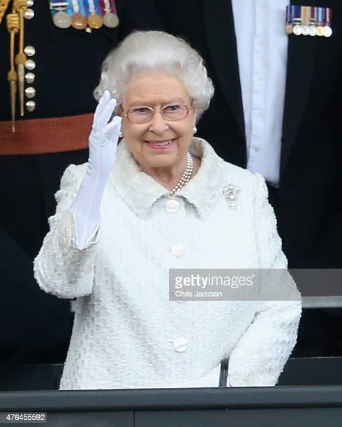 Queen Elizabeth II waves as she is saluted by Gurkhas at the Gurkha 200 Pageant at the Royal Hospital Chelsea on June 9 2015 in London EnglandFor two...