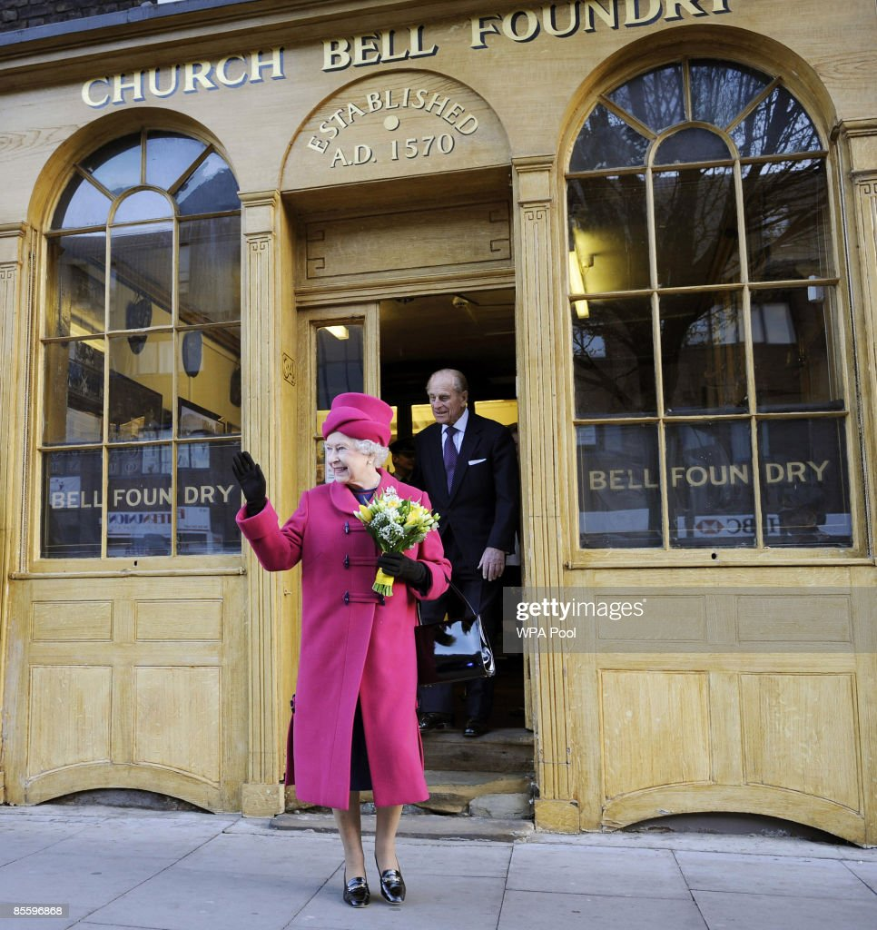 Queen Elizabeth II waves as she leaves the Whitechapel Bell Foundry with her husband Prince Philip Duke of Edinburgh on March 25 2009 in London...